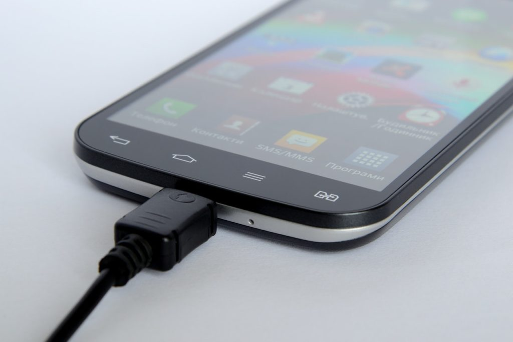 mobile phone connected with charger